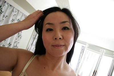 Playful MILF Takako Nishazawa revealing her small tits with hard nipples