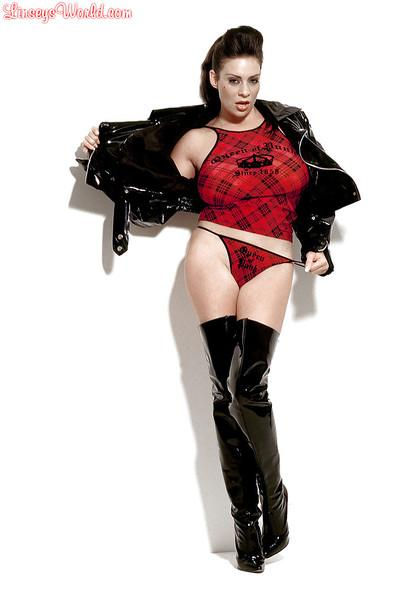 Hot Linsey Dawn McKenzie in a sexy latex jacket and boots.