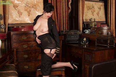Brunette MILF Nikita spreading hose covered legs to flash hairy vagina