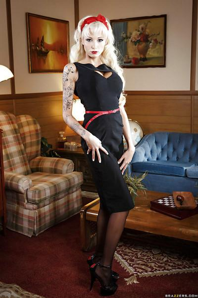 Tattooed blonde with nylon clad legs slowly uncovering her slender curves