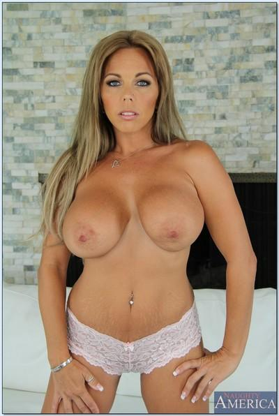 Big busted MILF Amber Lynn Bach stripping off her dress and lingerie