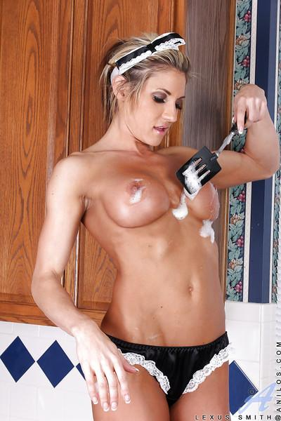 Gorgeous MILF in sexy maid uniform performs a steamy foodplay scene