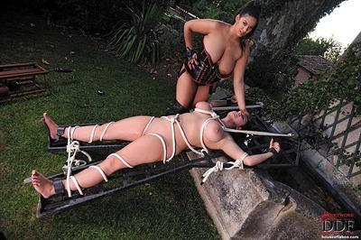 Big titted MILF mistress makes her tied up slave piss outdoor