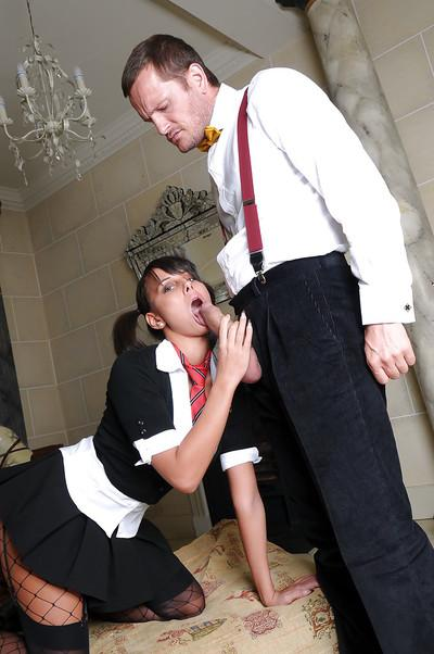 Pigtailed schoolgirl Melanie is getting fucked by two hard poles