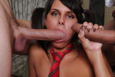 Pigtailed schoolgirl Melanie is getting fucked by two hard poles