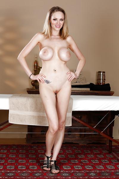 Big tits babe Katie Kox gets ready to get her milf ass massaged