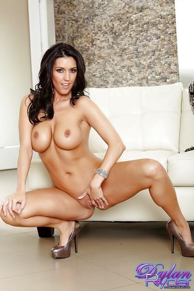 Milf pornstar with big tits Dylan Ryder is masturbating her shaved pussy