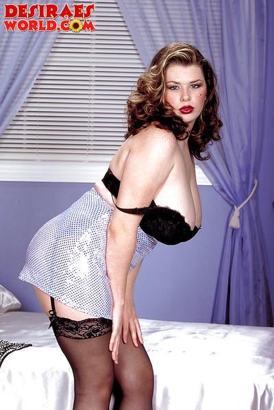 MILF pornstar Desirae flaunts huge juggs in stockings and garters