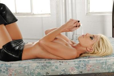 Busty MILF in high heeled boots Puma Swede showcasing her body and smoking