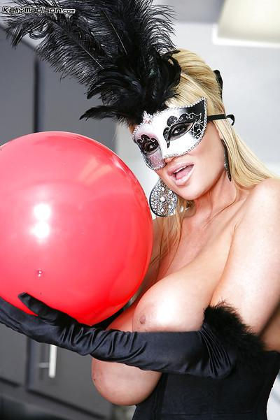 Kelly Madison is featured in a sexy posing scene while wearing a costume