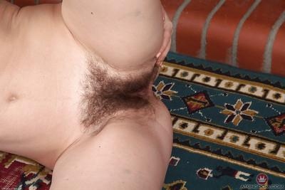 Older Euro MILF Olga Cabaeva spreading hairy pussy for close ups