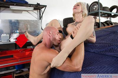 Inked girl Kleio Valentien licking long dick with pink tongue in garage