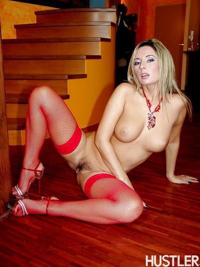 European MILF Daria Glower posing solo in lingerie and fishnet stockings