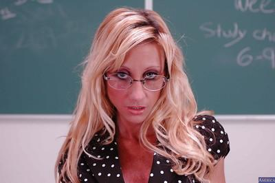 Milf teacher in sexy glasses and stockings Regan Anthony poses