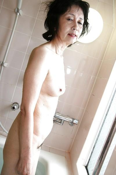 Asian milf Michiyo Fukumoto shows off her tiny tits while in bathroom