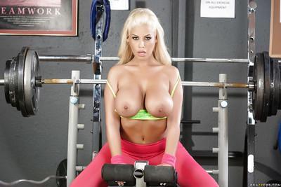Busty blonde Latina pornstar Bridgette B working out in yoga pants
