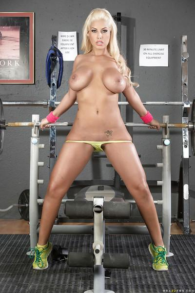 Busty blonde Latina pornstar Bridgette B working out in yoga pants