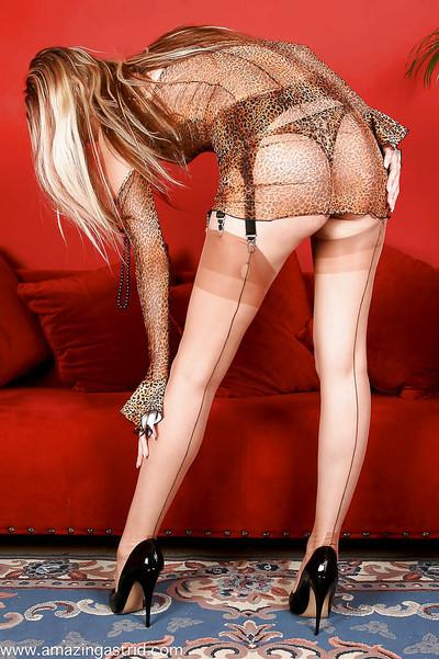 Hot blonde MILF in stiletto heels showing off nylon tops and garters