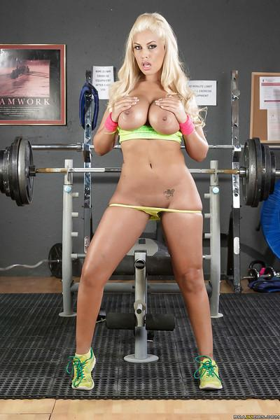 Latina pornstar Bridgette B lets her big hooters loose during workout
