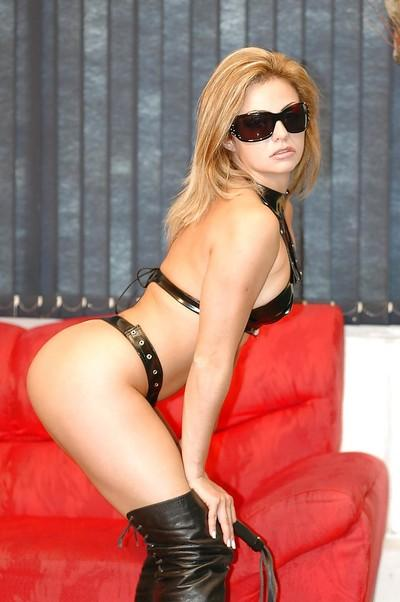 Steamy MILF in sunglasses and fetish outfit posing and teasing her gash