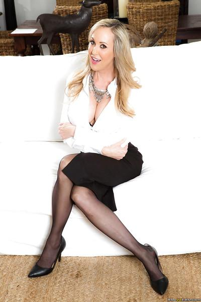 Blonde MILF Brandi Love modeling topless in black stockings and pumps