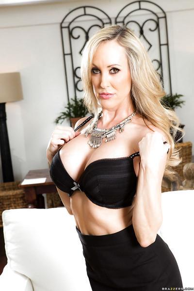 Blonde MILF Brandi Love modeling topless in black stockings and pumps