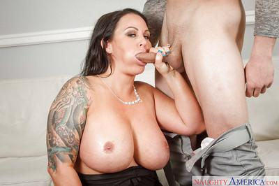 Maci Maguire is a tattoo covered mom that loves giving blowjobs