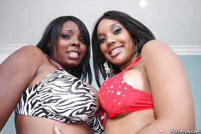 Ravenous ebony lesbians Capri Styles and Stacy Adams oil their tits