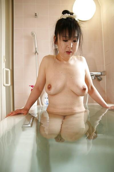 Close up posing action with an Asian milf Ayako Shibahara in bathroom