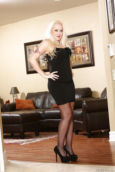 Top heavy blonde pornstar Alana Evans flashing leg and upskirt undies