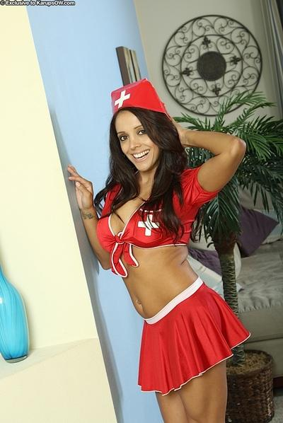 Latina MILF babe drops her red nurse uniform to play with her cunt