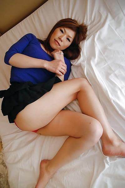 Asian MILF in pantyhose undressing and exposing her gash in close up
