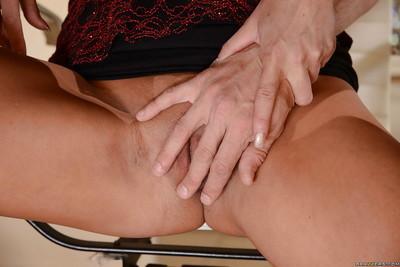 Ravishing brunette cougar Nikki Daniels giving a big dick some pleasure