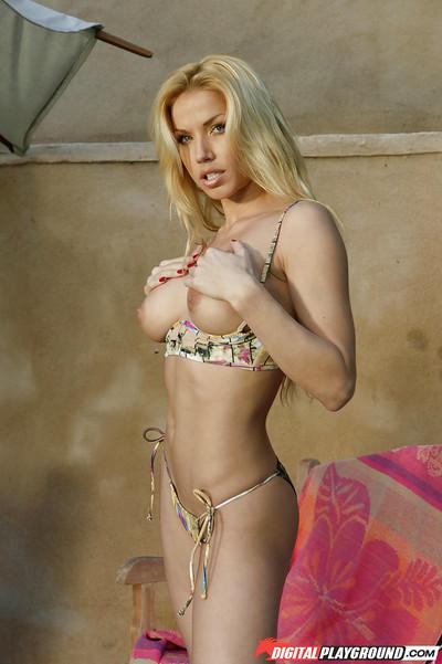 Blonde babe Angie Savage posing and stripping out of her bikini