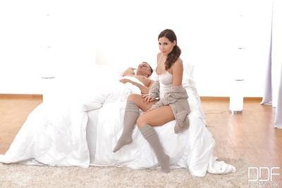 Busty Latina mom Satin Bloom uses bare feet to jerk long cock