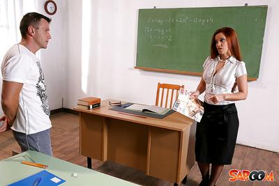 Slutty redhead teacher in stockings gets shagged in the classroom