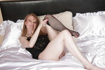 Sexy redheaded milf Natalia is revealing her tight cunt in close up