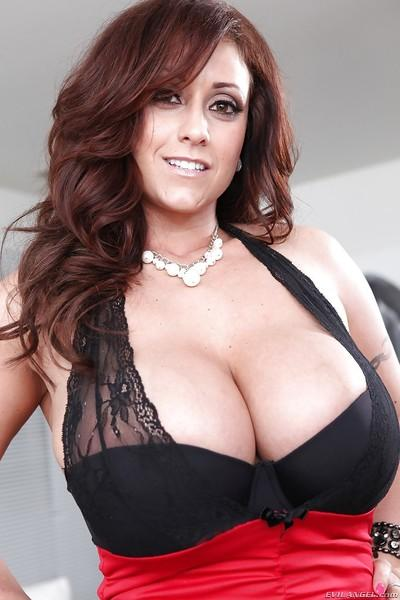 Ravishing MILF in glasses uncovering and squeezing her massive boobs