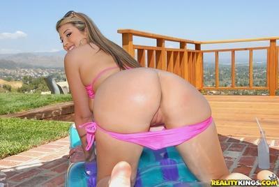 Plump MILF Athena Pleasures posing in sexy pink bikini on the roof