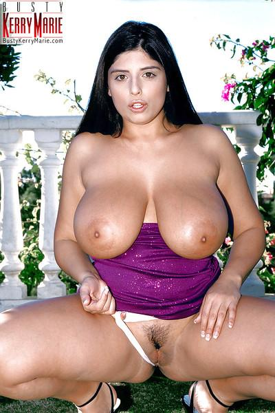 Plump Euro pornstar Kerry Marie baring huge tits and spread cunt outdoors