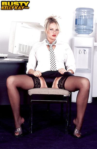 European MILF pornstar Kelly Kay releasing huge knockers in office
