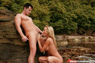 Blonde Devon is giving a gorgeous deep blowjob on the beach!