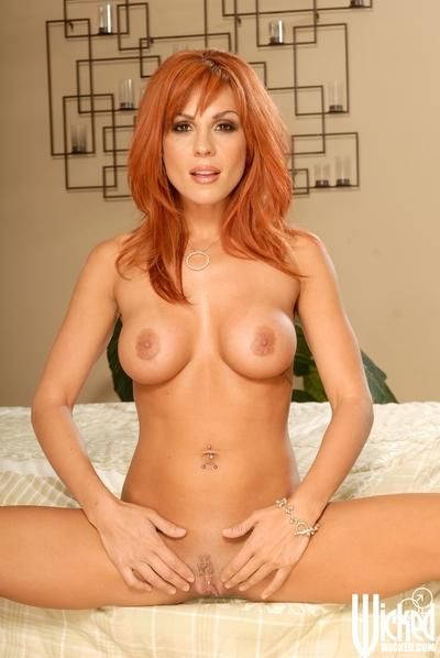Redhead babe with big tits Kirsten Price taking off her pink panties