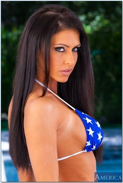Lusty brunette MILF Jessica Jaymes exposing her seductive body outdoor