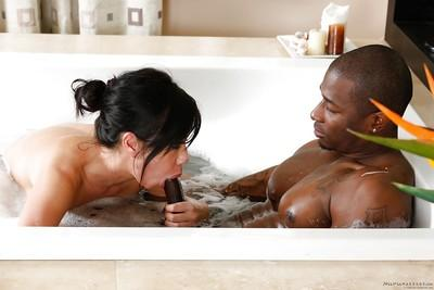 Busty MILF Kimmy Lee jacking off a long black cock in bathtub