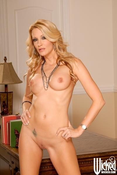MILF Jessica Drake spreading her pink hole right on the office table