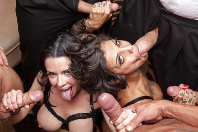 Glamorous brunette sluts in stockings enjoys a fervent gangbang action