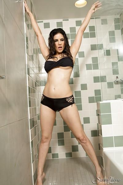 Milf pornstar Sunny Leone is taking a hot shower while in her lingerie