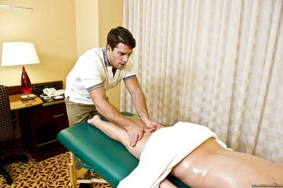 Milf pornstar with sexy tattoos Claire Dames receiving a massage