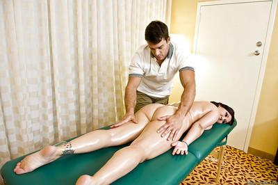 Milf pornstar with sexy tattoos Claire Dames receiving a massage